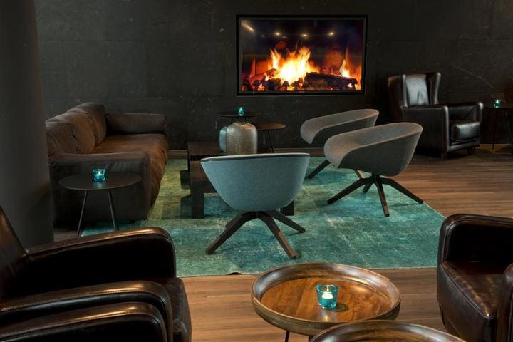 Lounge mit Kamin Motel One München Campus - iba 2021 Hotel Motel One Munich Campus
